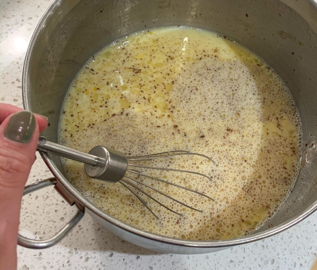 whisking egg mixture for bread pudding